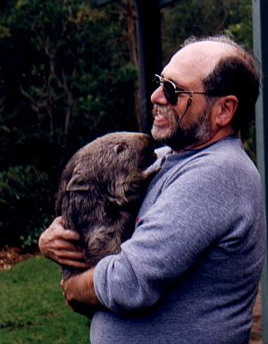 jan howard finder holds a wombat on his trip to Australia